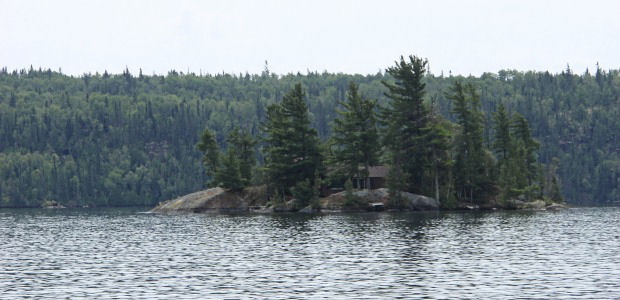 Cabin on an island in the middle of the lake. Isolated.