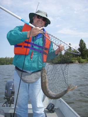 Jim holding a net with a 33 inch pike in it.