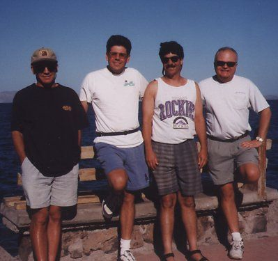 4 guys standing at the beach in Loreto, Baja