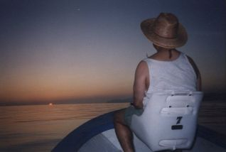 Rick sitting in a skiff watching the sun rise over the Gulf of California